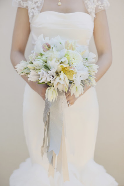 bridal bouquet with blushing bride protea