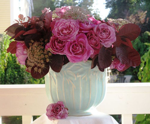 Designed by Debra Prinzing - Featuring American-grown old garden roses, smoke bush foliage and pink Queen Anne's lace.