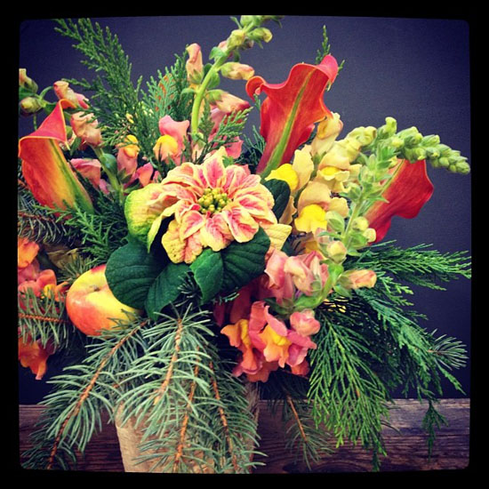 colorful centerpiece with poinsettias, callas and snapdragons