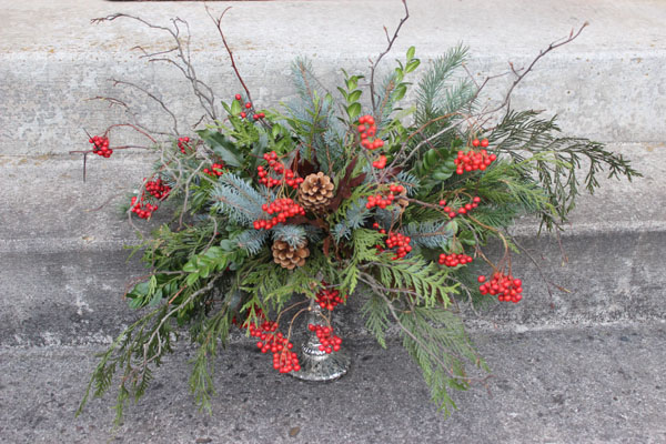 holiday foliage with berries arrangement