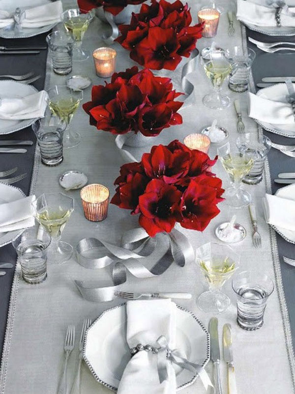 red amaryllis and silver table setting