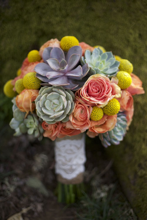bridal bouquet of orange, yellow and succulents by Bella Fiori