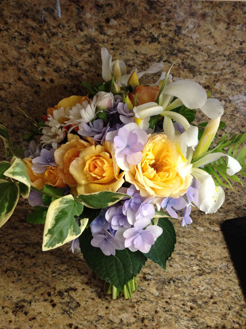 bridal bouquet of blue hydrangeas, yellow roses and iris