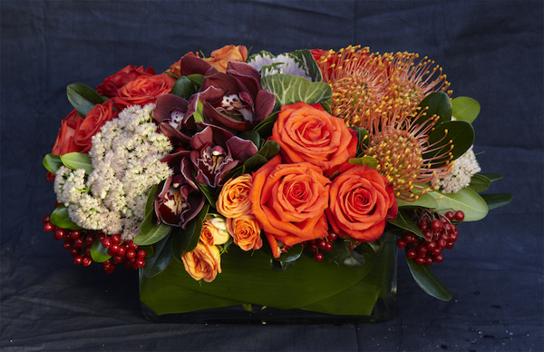 orange and burgundy flower arrangement by Bloom Denver