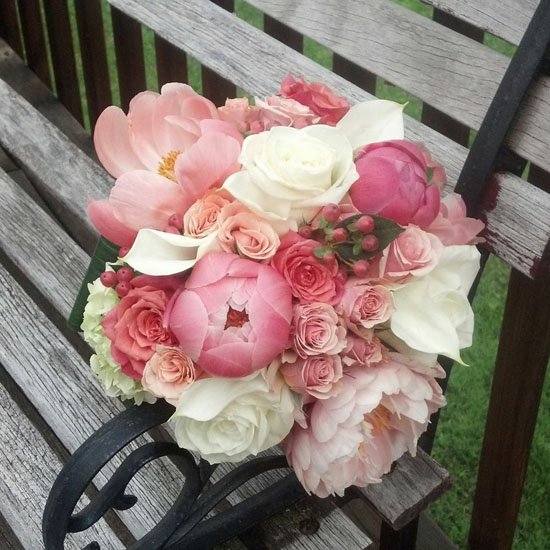 Blooms N Blossoms bridal bouquet of coral pink and white flowers