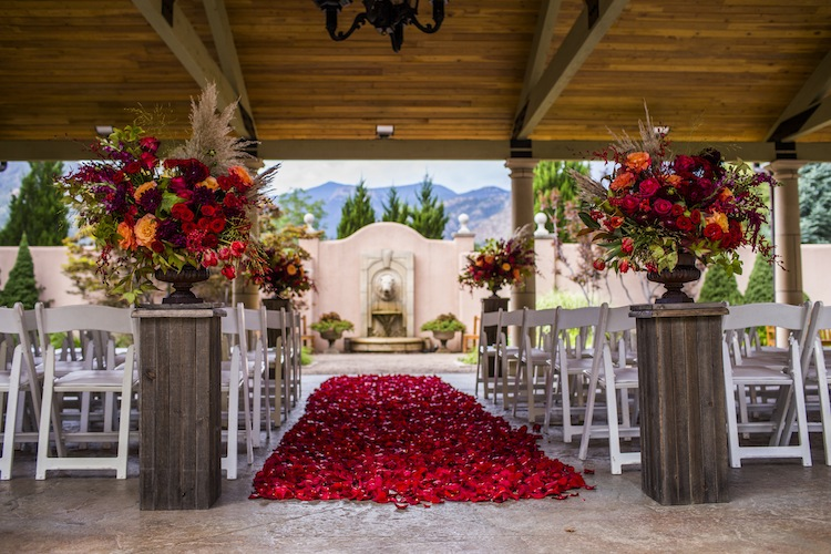 Lush aisle petals on The Broadmoor, designed by Cori Cook