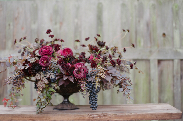 Max Gill, plum and burgundy flower arrangement