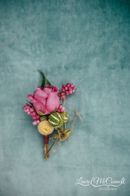 Floressence, boutonniere of a rose and cucumis