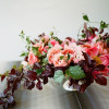 Designed by Ariella Chezar, Coral peonies, coral garden roses, plum branches