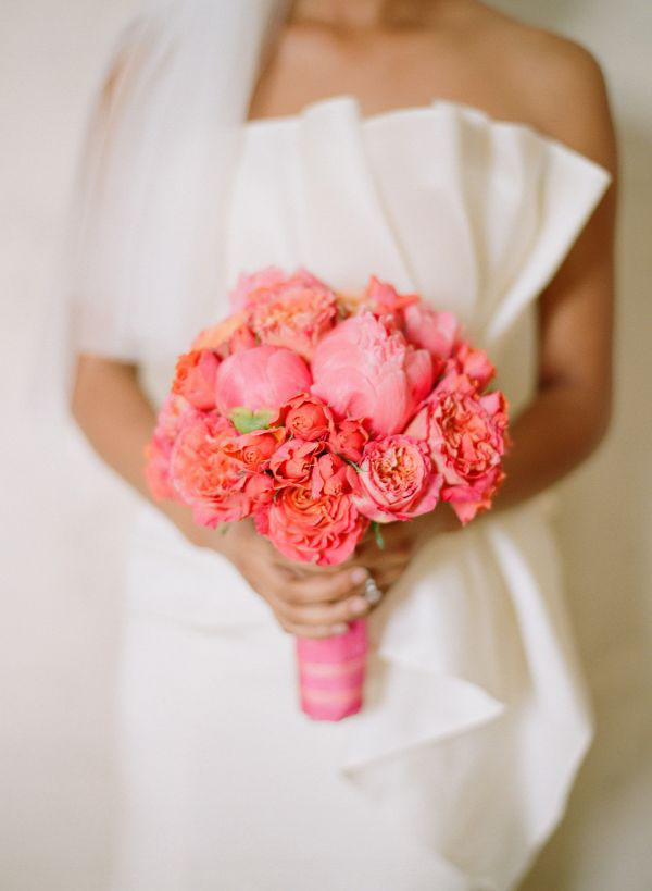Dolce Design Studios, Bridal bouquet of coral peonies and coral garden roses.