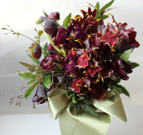 Florali bouquet of orchids and ranunculus