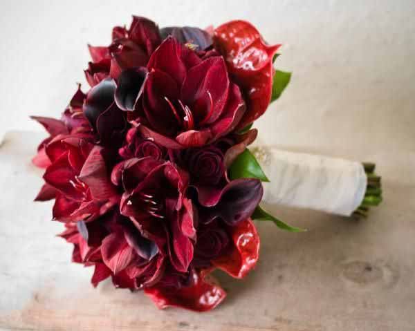 Flourish Bridal bouquet of red amaryllis anthirium calla lilies cymbidium orchids