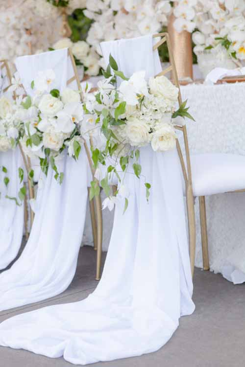 Joseph Matthew Photography, White and Green Flowers on reception chairs
