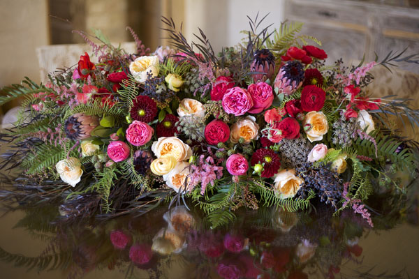 The Chapel Designers, hot pink, peach, burgundy floral arrangement