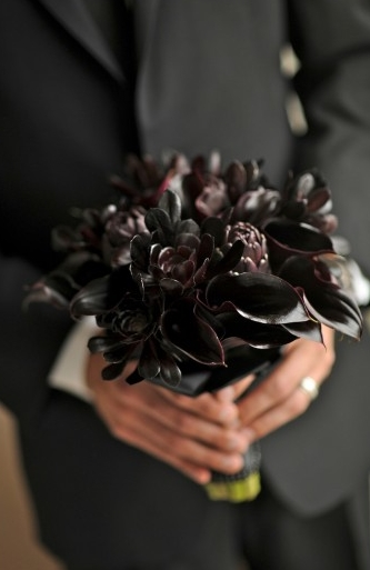 Black bridal bouquet of succulents, calla lilies and artichokes