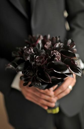 Black bridal bouquet of succulents, calla lilies and artichokes