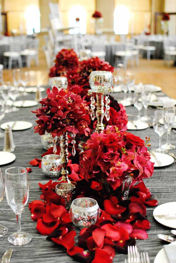 Fuscia Designs, Glamourous red centerpieces with orchids and roses