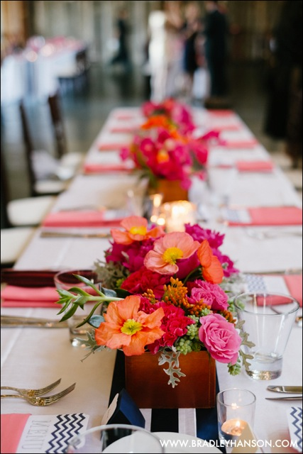 Floressence, Pink and Coral centerpieces of poppies and ranunculus