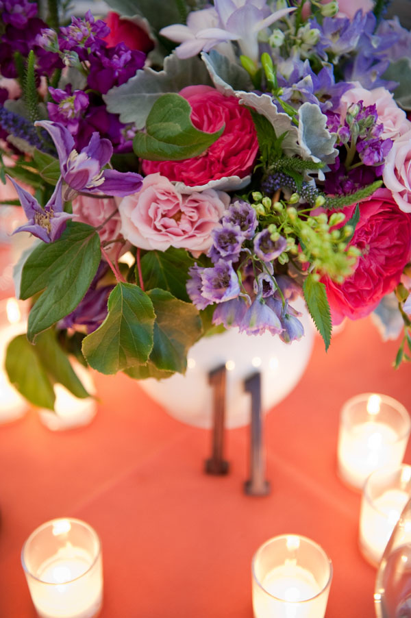Emily Carter Floral Design - Floral Centerpiece with hot pink garden roses, light pink roses, purple stock, purple veronica, purple clematis and dusty miller, purple freesia, purple delphinium
