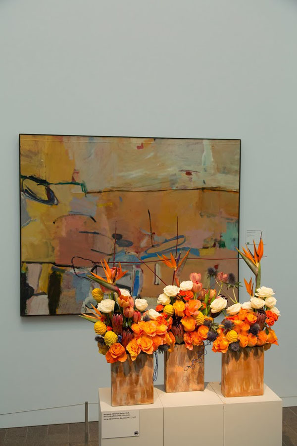 Bouquets To Art San Francisco, Richard Diebenkorn, Berkeley #3, 1953. Oil on canvas. Fine Arts Museums of San Francisco, bequest of Josephine Morris. Floral design by Woodside-Atherton Garden Club. Photograph © Greg A. Lato / latoga photography