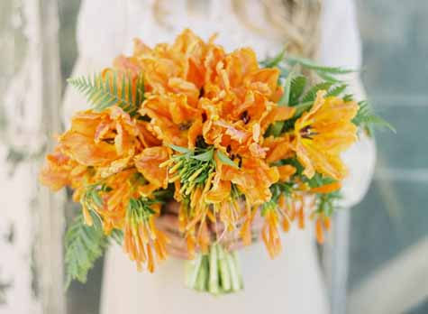 Flower Wild, Jose Villa, Bridal bouquet of orange parrot tulips and ferns.