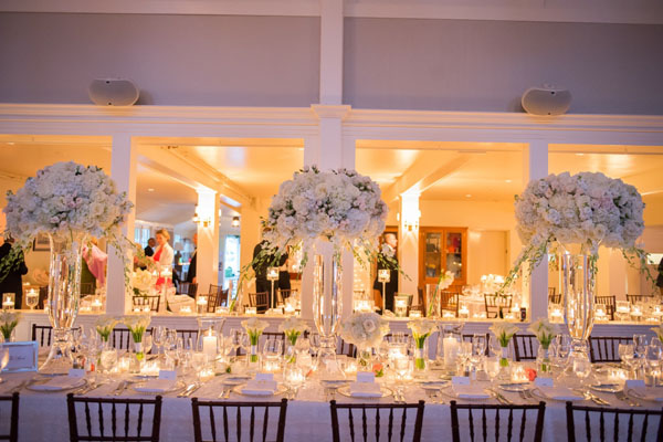 Brea McDonald Photography and Soiree Floral of Nantucket, Elevated centerpieces of white flowers that include roses, hydrangeas and dendrobrium orchids