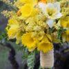 Bella Fiori, Yellow daffodil, ranunculus and acacia bridal bouquet.