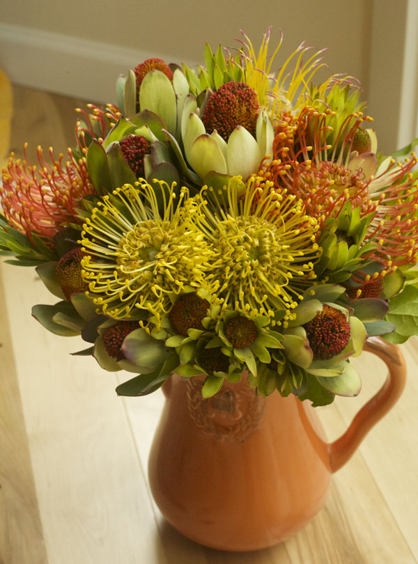 Flower arrangement with pincushion protea and leucadendrons from Resendiz Brothers