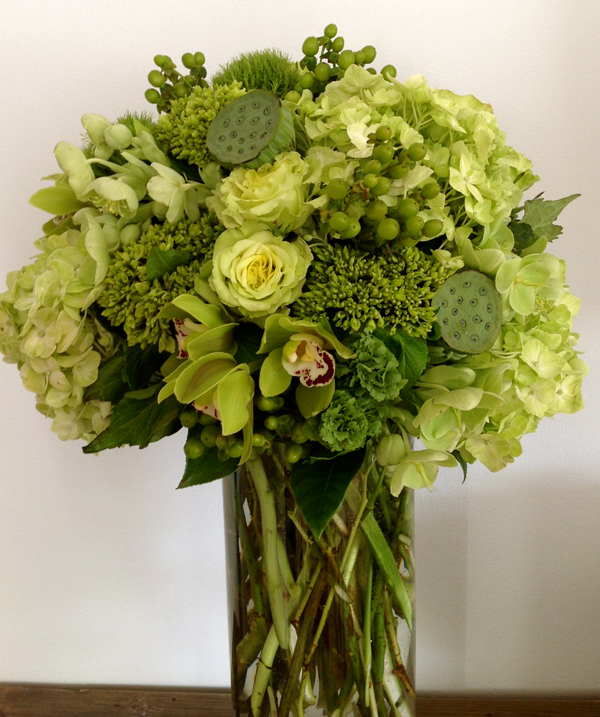 Green Bouquet Floral Design; Centerpiece of green hydrangea, green hypericum berries, super green roses, green cymbidiums, green lotus pods