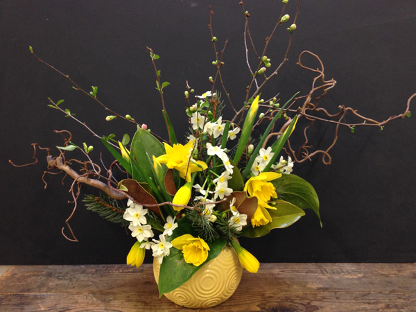 Local Color Flowers, arrangement of quince, yellow daffodils, white paperwhites, yellow iris