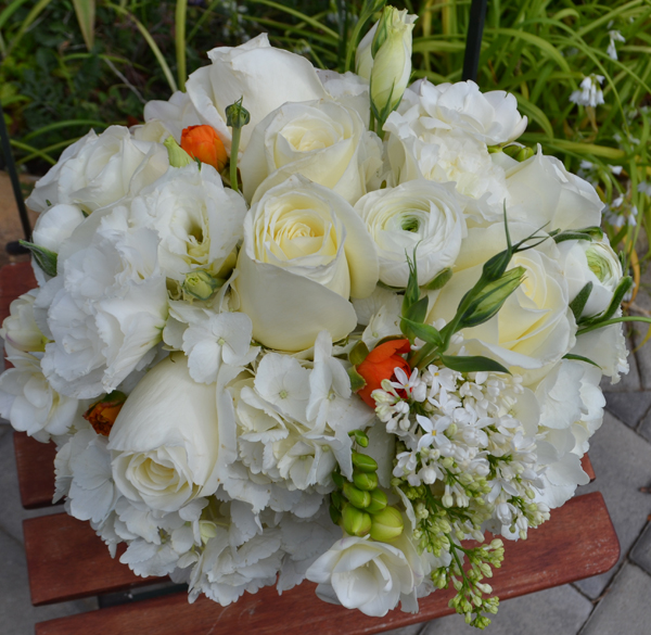 Fleurish, Bridal bouquet of white ranunculus, roses, hydrangeas, lilacs, lisianthus and freesia