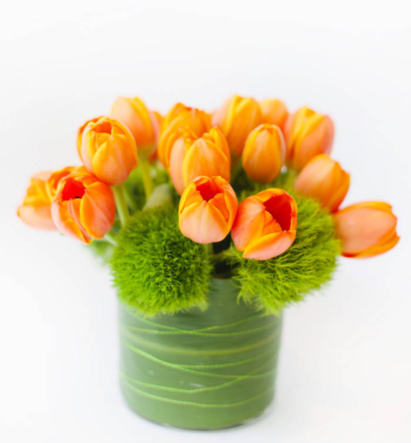 Le Printemps, arrangement of orange tulips and green trick dianthus