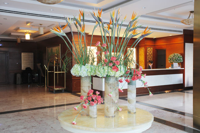 38 Degree Flowers Co., Hotel Lobby in Vietnam, Floral Display of Birds of Paradise, green hydrangea and coral carnations