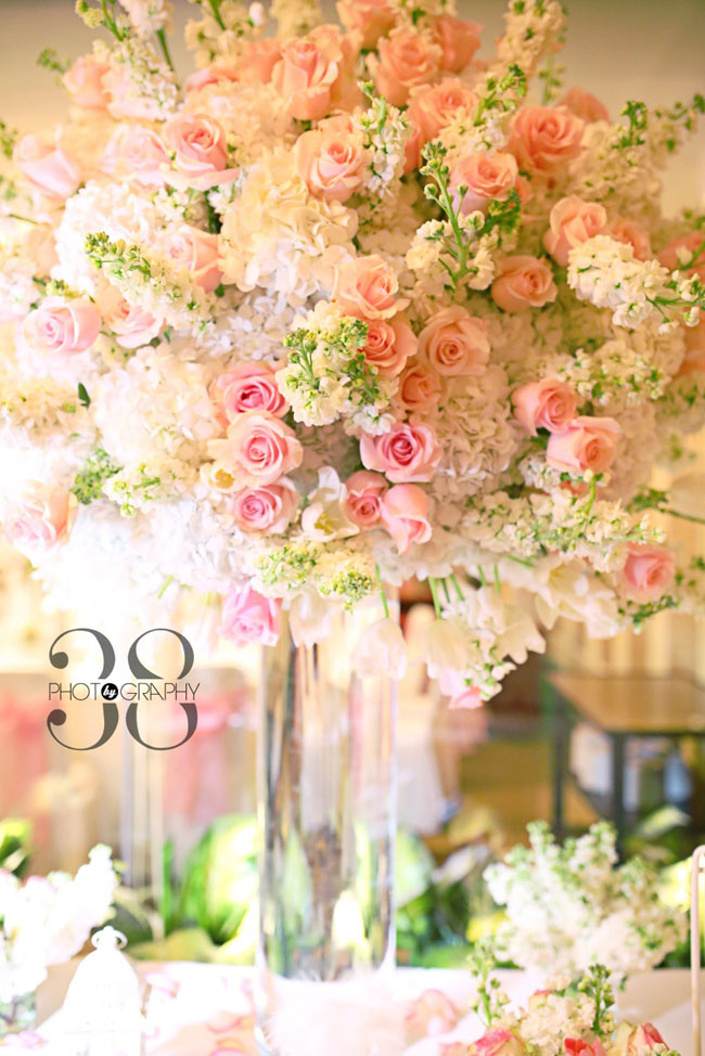 38 Degree Flowers Co. Elevated floral design of pink roses, white stock and white larkspur, white hydrangea and pink tulips