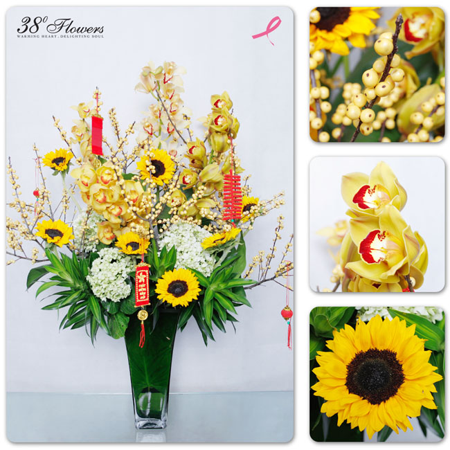 38 Degree Flowers Co, Arrangement of gold cymbidium orchids, yellow sunflowers, yellow ilex berries, hydrangeas