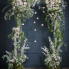 Jay Archer Floral Design, Wedding ceremony arch with draping greenery, pink roses, nerines, larkspur, clematis