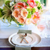 Camille Styles, Centerpiece of coral charm peonies, juliet garden roses, airplants
