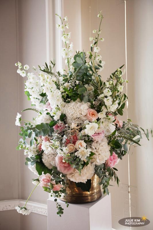 Jay Archer Floral Design, floral arrangement of white hydrangeas, white larkspur, pink roses, scabiosa, eucalyptus