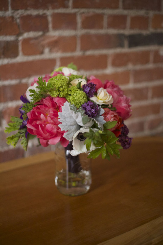 Flirty Fleurs Floral Design Workshop, Bridal bouquet of coral charm peonies, green viburnum, white garden roses, lilacs, dusty miller and clematis