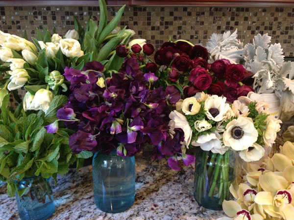 Florabundance Wholesale - Mint, Green & White Parrot Tulips, Purple SweetPeas, Burgundy Ranunculus, Panda Anemones, Dusty Miller and Green Cymbidium Orchids
