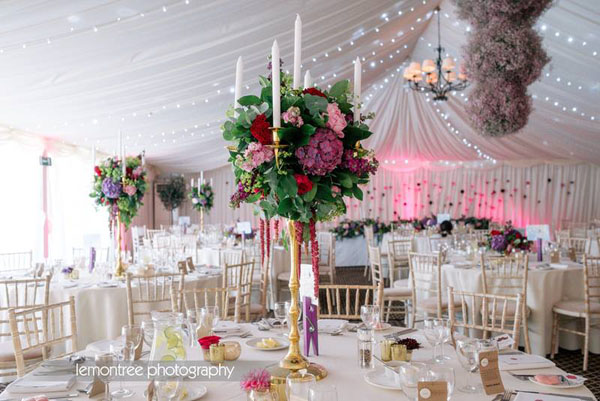 Jay Archer Floral Design, tall centerpiece at a reception with pink and burgundy and pink flowers