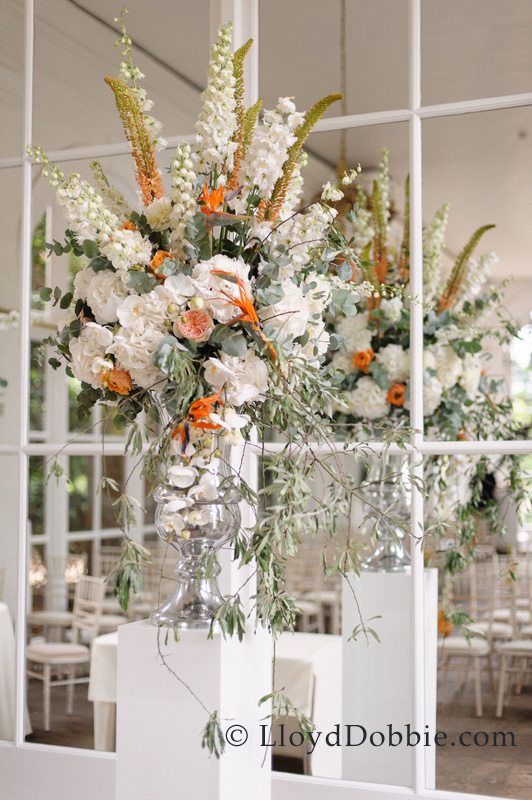 Jay Archer Floral Design, Tall centerpiece with white, peach and orange flowers