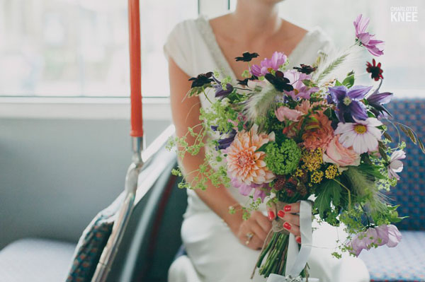 Jay Archer Floral Design, bridal bouquet of orange dahlias, chocolate cosmos, pink cosmos, clematis, viburnum