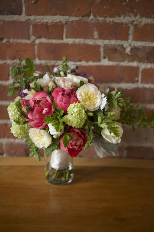 Flirty Fleurs Floral Design Workshop, Bouquet designed by Shawn Chamberlain, Bridal bouquet of Coral Charm Peonies, Viburnum, White Garden Roses, Dusty Miller, Scented Geranium, Mint.