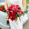 The Village Green Florist, Red peony bouquet with scabiosa pods and succulents