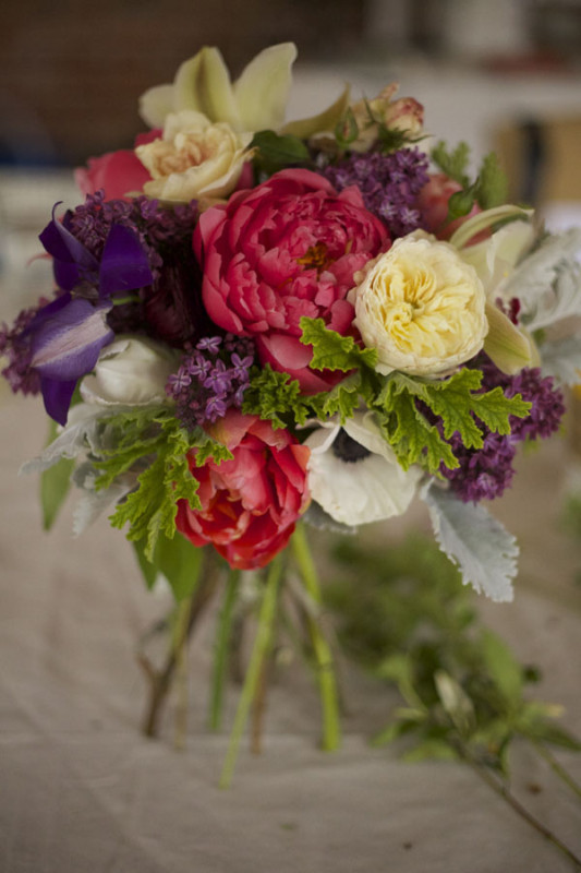 Flirty Fleurs Floral Design Workshop, Bouquet by Lisa Krauter, European Hand-tied bridal bouquet of coral charm peonies, purple clematis, anemones, white garden roses, cymbidium orchids, lilacs, scented geranium