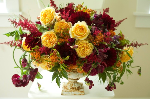 Bella Fiori, Rustic Urn filled with gold garden roses, burgundy dahlias, red astilbe, purple sweetpeas