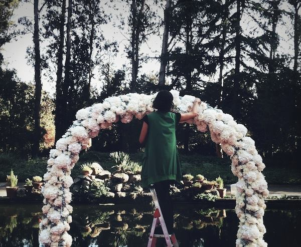 Bornay, Spain, floral designer creating an arch