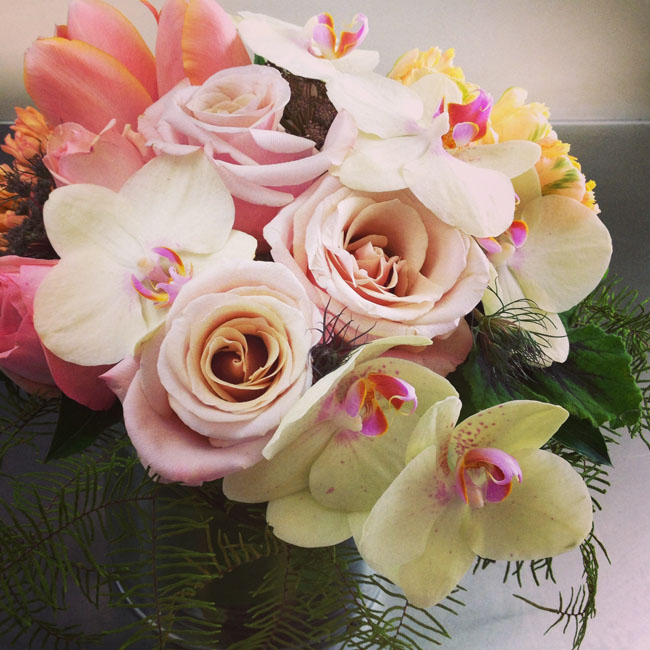 Cymbidium Flower Shop, New Hampshire - flower arrangement of orchids and roses