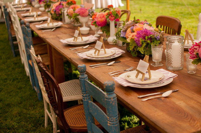 Cymbidium Flower Shop, New Hampshire - rustic long table set with vintage milk glass and pink and orange dahlias